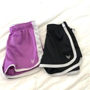 2 pairs of girls Justice Shorts. Size 7